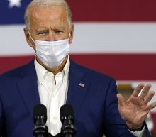 As death toll climbs, Biden warns against becoming 'numb' to COVID-19