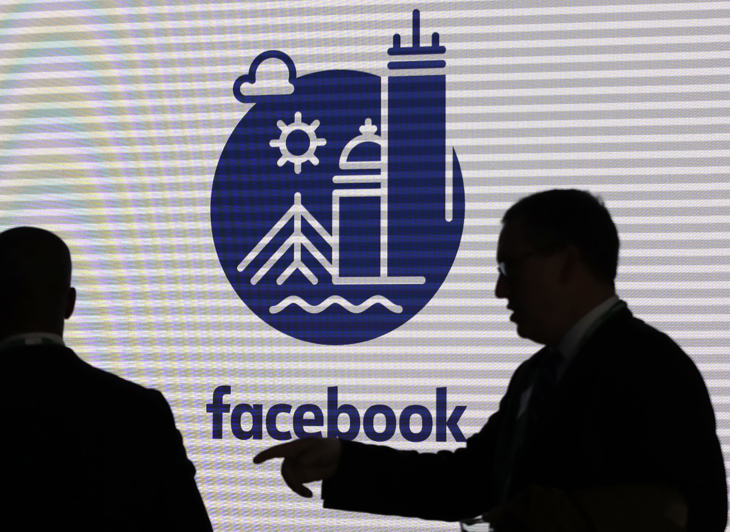FILE - In this Jan. 9, 2019, file photo, media and guests mingle before a tour of Facebook's new 130,000-square-foot offices, which occupy the top three floors of a 10-story Cambridge, Mass., building. Executives from Google and Facebook are facing Congress Tuesday, April 8, to answer questions about their role in the hate crimes and the rise of white nationalism in the U.S. (AP Photo/Elise Amendola, File)