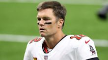 Brady brushes off losing debut after throwing two interceptions for Bucs