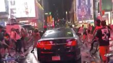 A car plowed through Black Lives Matter protesters in Times Square, and the NYPD had to deny accusations it was one of its unmarked vehicles