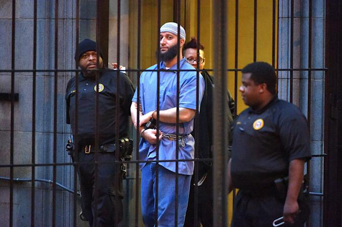 """Officials escort """"Serial"""" podcast subject Adnan Syed from the courthouse on Feb. 3, 2016, following the completion of the first day of hearings for a retrial in Baltimore, Md. (Karl Merton Ferron/Baltimore Sun/Tribune News Service via Getty Images)"""