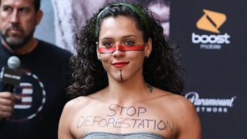 MMA fighter covers body in deforestation protests