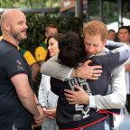 Prince Harry inspires athletes as pregnant Meghan trims Australia schedule