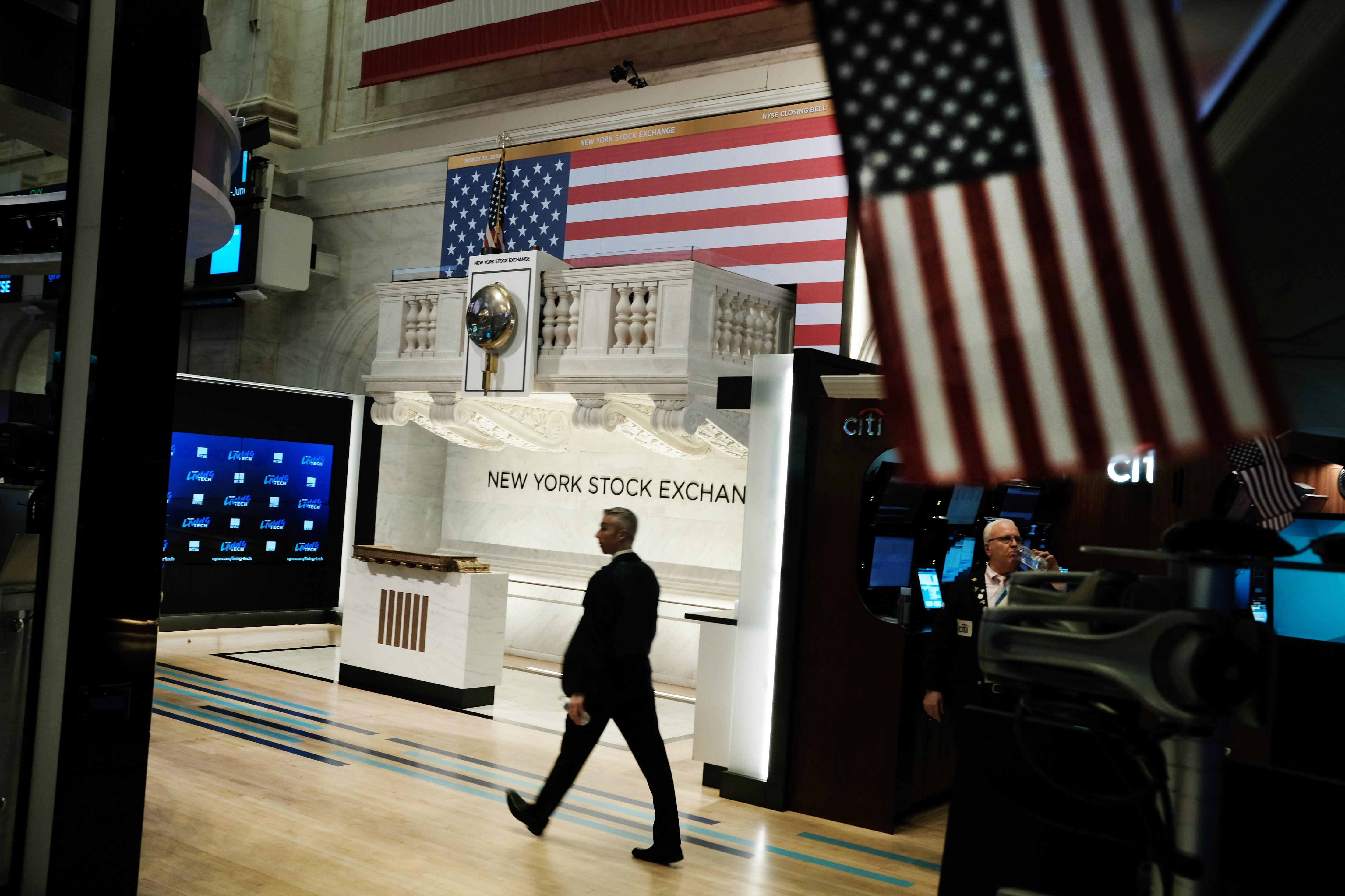 Stock futures tumble, hit limit down