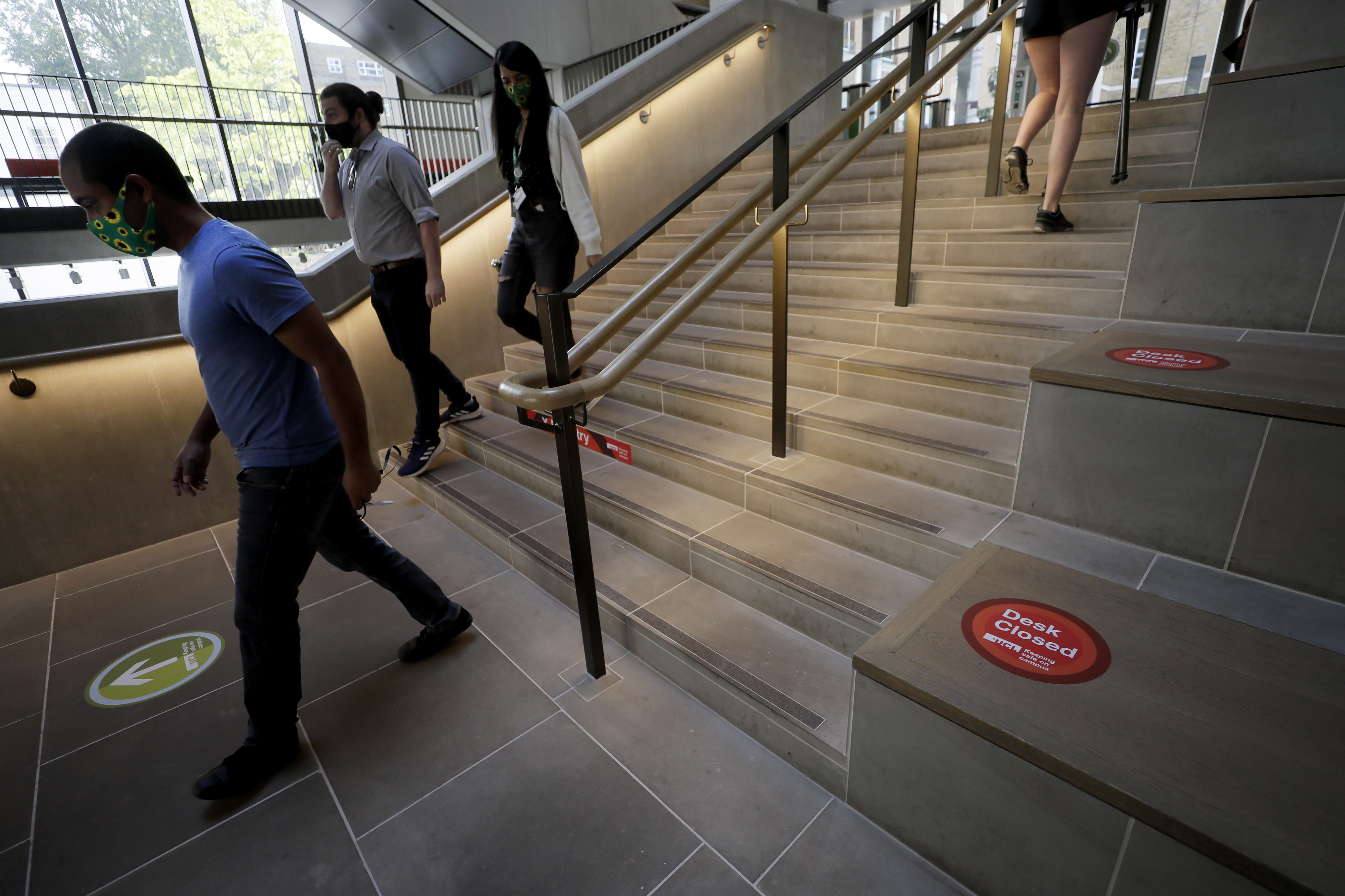 Arrows mark a one way walking system at UCL (University College London) in London, Thursday, Sept. 17, 2020. The university is preparing its return to campus COVID-19 measures. (AP Photo/Kirsty Wigglesworth)