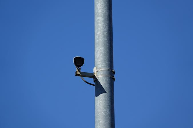 31 July 2020, Berlin: A surveillance camera is mounted on a mast. Photo: Alexandra Schuler/dpa (Photo by Alexandra Schuler/picture alliance via Getty Images)