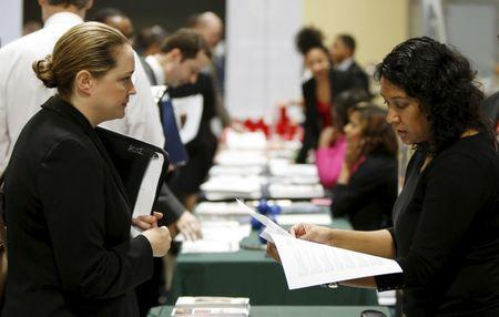 Good U.S. payrolls gains seen, but swelling labor force to cap wage growth
