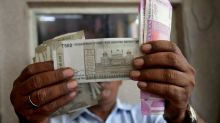Rupee breaches 71 per dollar on 'chunky outflows'