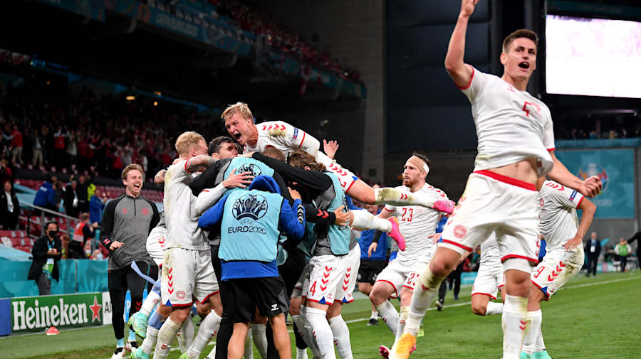 Denmark rides inspired rally into knockout stage