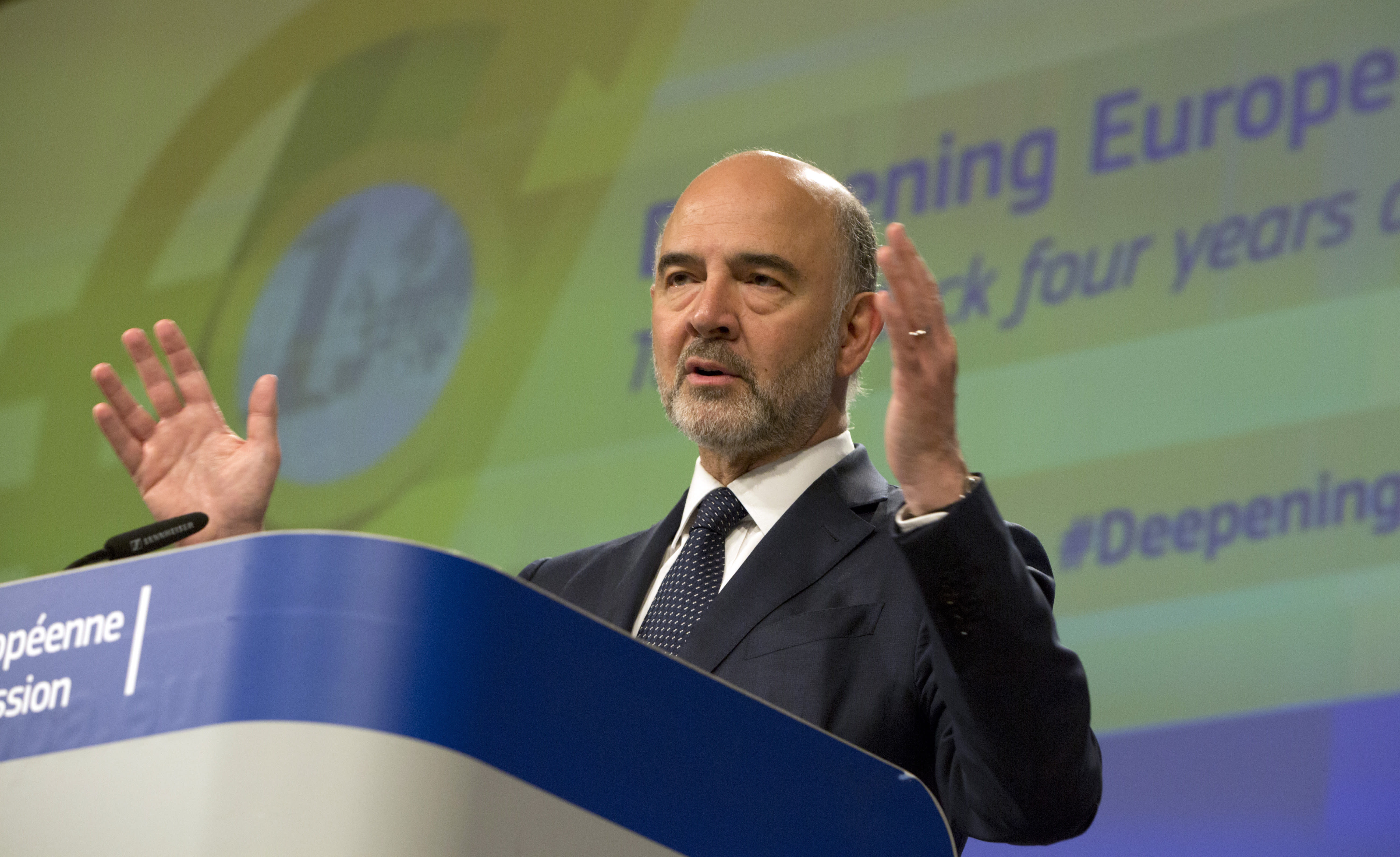 European Commissioner for Economic and Financial Affairs Pierre Moscovici speaks during a media conference at EU headquarters in Brussels, Wednesday, June 12, 2019. The European Commission on Wednesday took stock of the progress made to deepen Europe's Economic and Monetary Union and calls on Member States to take further concrete steps. (AP Photo/Virginia Mayo)