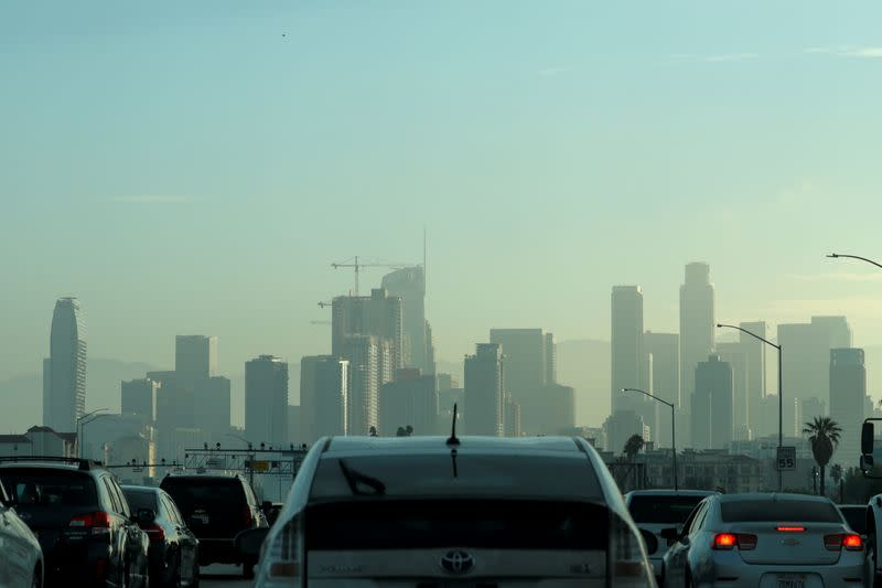 FILE PHOTO: Commuters navigate early morning traffic as they drive towards downtown in Los Angeles, California