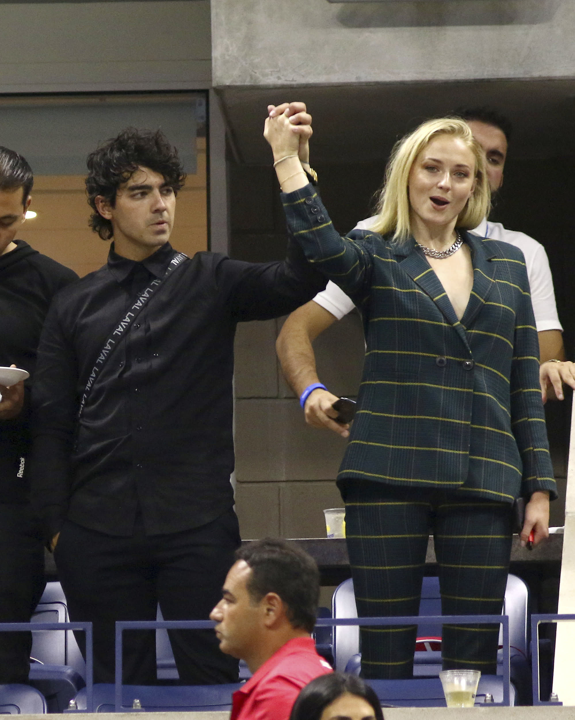 Joe Jonas, left, and Sophie Turner attend the third round of the U.S. Open tennis tournament at the USTA Billie Jean King National Tennis Center on Friday, Aug. 31, 2018, in New York. (Photo by Greg Allen/Invision/AP)