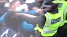 Shocking moment protester pushes police officer down stairs during demonstration to 'protect statues' in Westminster