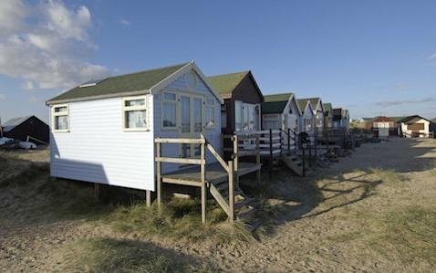 Picture shows a row of luxury beach huts on Mudeford Spit in Dorset - Credit: Geoff Pugh