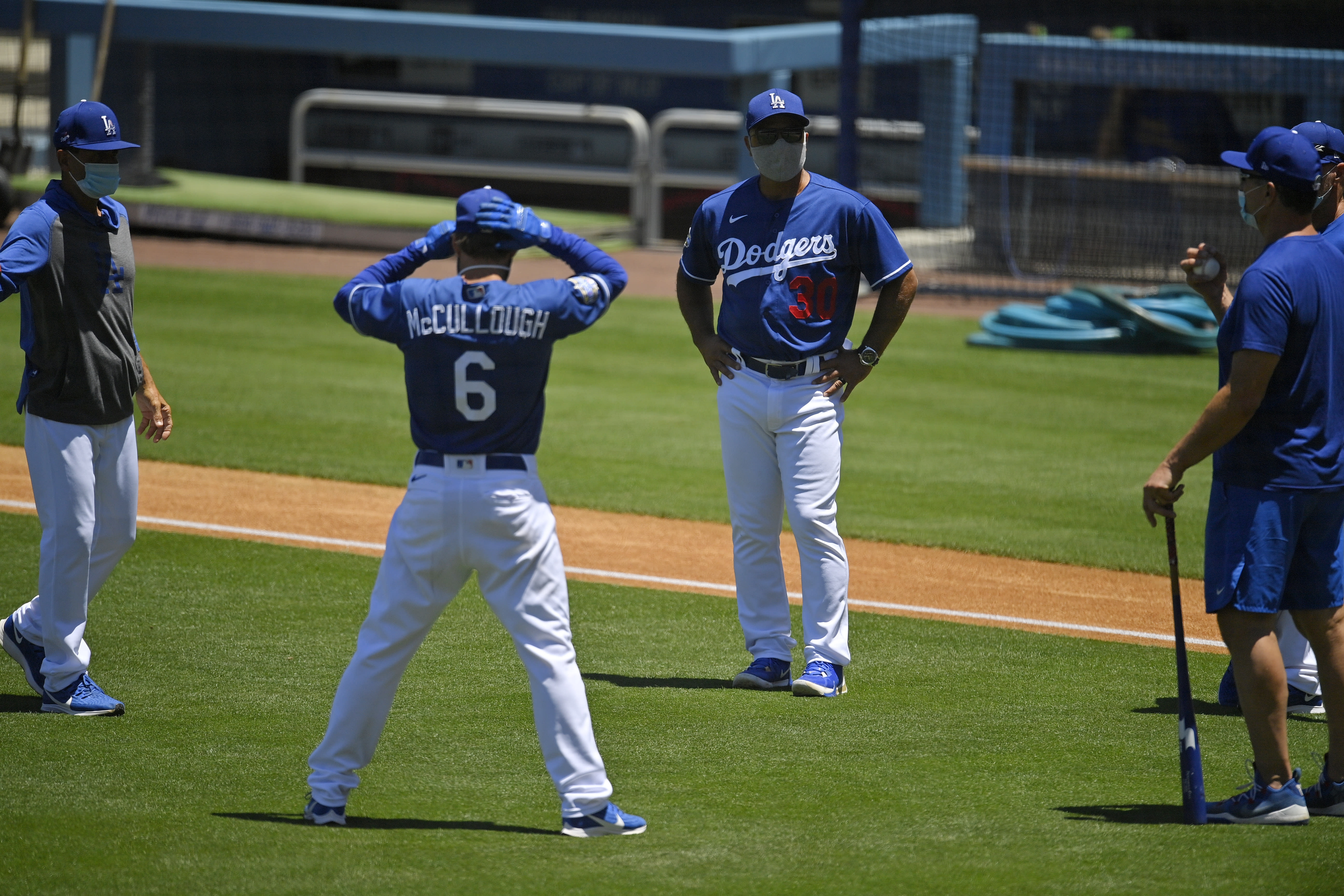 Los Angeles Dodgers manager Dave Roberts (30) talks with members of the team during the restart of spring training Friday, July 3, 2020, in Los Angeles. (AP Photo/Mark J. Terrill)