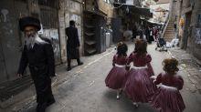 Purim celebrations threaten fresh virus outbreak in Israel