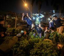 Hong Kong university protesters defy surrender warnings