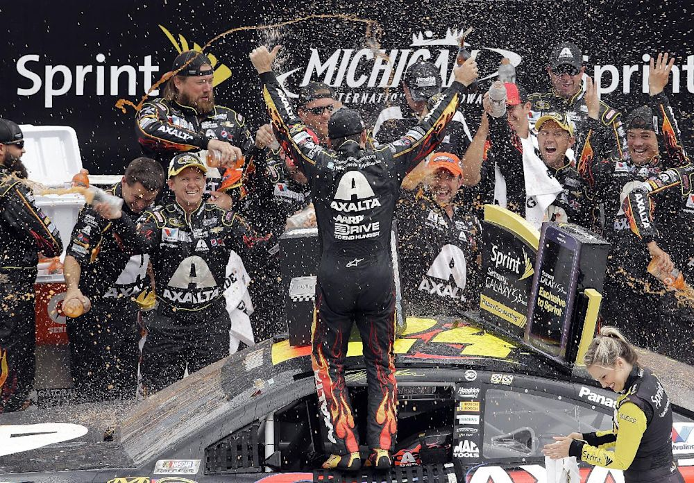 Jeff Gordon celebrates his victory with his crew after the NASCAR Sprint Cup Series Pure Michigan 400 auto race at Michigan International Speedway in Brooklyn, Mich., Sunday, Aug. 17, 2014