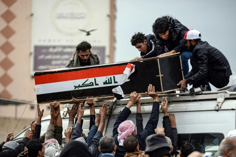 Iraqi mourners in the Shiite holy city of Najaf have been burying protesters killed in clashes with security forces (AFP Photo/Haidar HAMDANI)