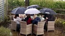 Family snapped eating lunch in torrential rain call on Boris Johnson to open pubs immediately