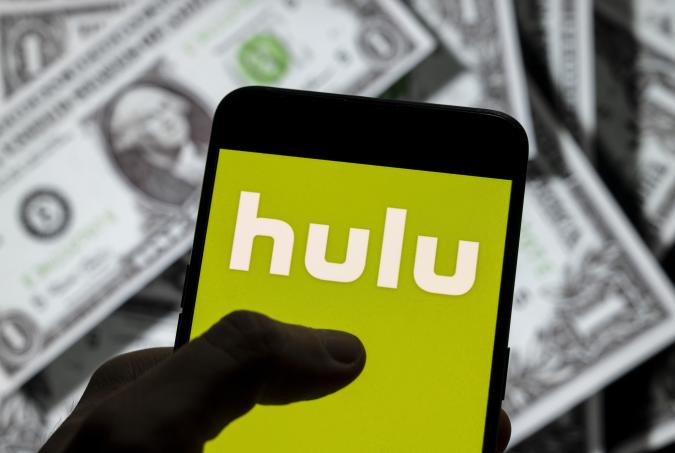 CHINA - 2021/04/14: In this photo illustration, the American global on-demand Internet streaming media provider Hulu logo is seen on an Android mobile device screen with the currency of the United States dollar icon, $ icon symbol in the background. (Photo Illustration by Chukrut Budrul/SOPA Images/LightRocket via Getty Images)