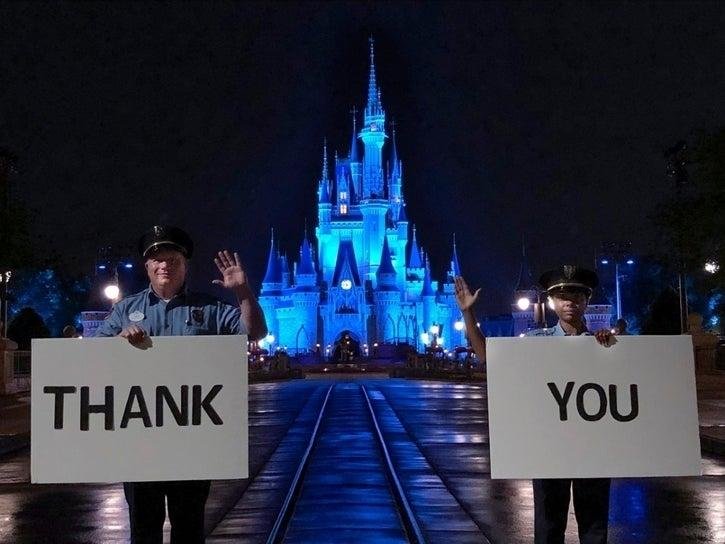 The Magic Kingdom lights up in blue to support front-line workers during the coronavirus pandemic.