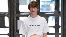 Males models walk the runway with fake pregnant bellies in controversial fashion show
