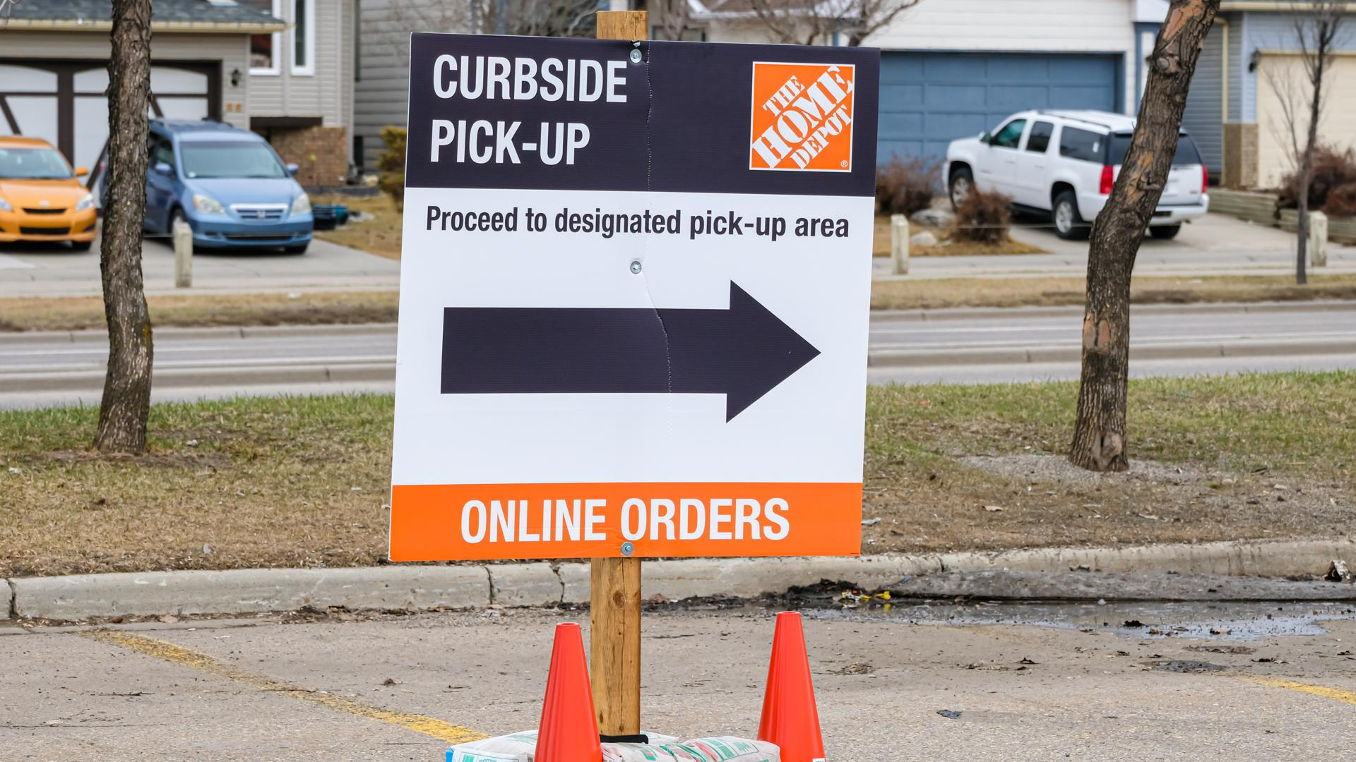 April 25 2020 - Calgary, Alberta Canada - directing cutomers for curbside pickup covid-19 corona virus pandemic.