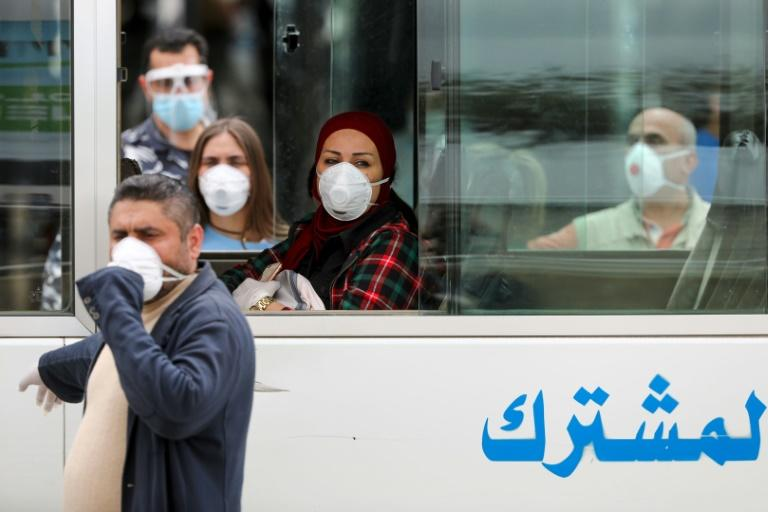 Lebanese nationals returned from Saudi Arabia board buses upon their arrival at the Beirut international airport (AFP Photo/ANWAR AMRO)