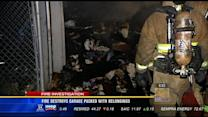 Fire destroys house garage packed with belongings