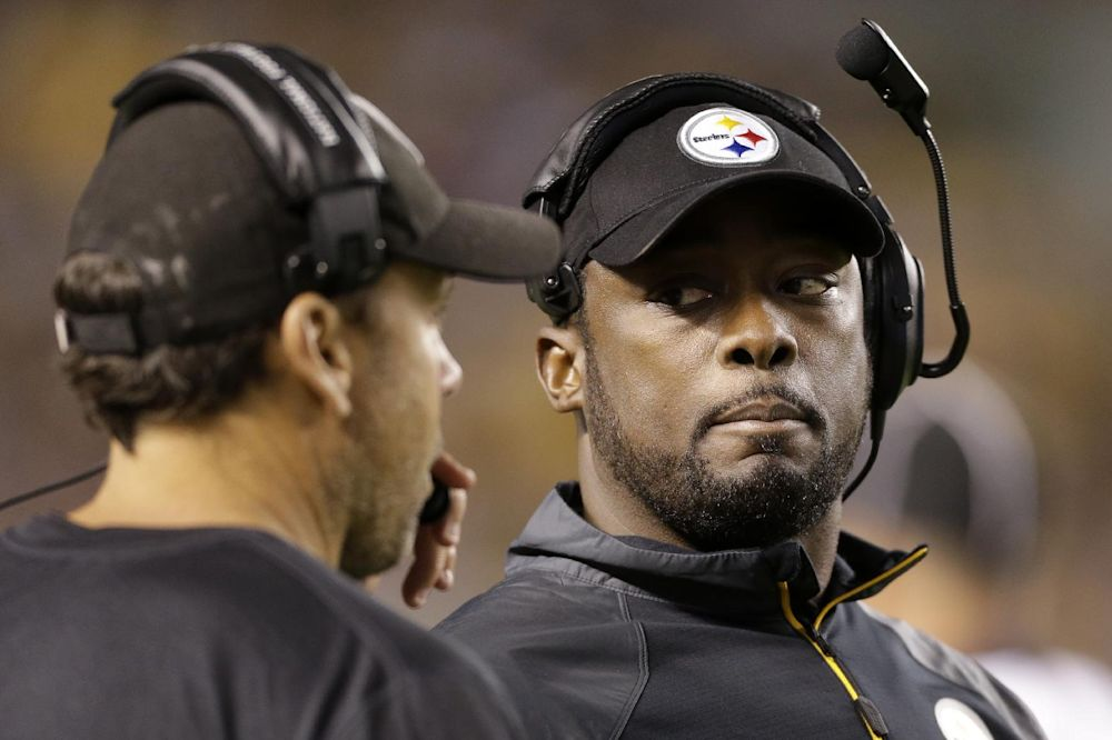 """In this Sept. 22, 2013 file photo, Pittsburgh Steelers head coach Mike Tomlin, right, talks with offensive coordinator Todd Haley during the fourth quarter of an NFL football game against the Chicago Bears, in Pittsburgh. The arrow for the Steelers is, as coach Tomlin likes to say, """"pointing up"""" heading into a showdown with AFC North rival Baltimore"""