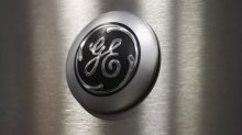 General Electric cuts dividend by 50% amid restructuring