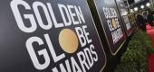 Event signage appears above the red carpet at the 77th annual Golden Globe Awards. (AP)