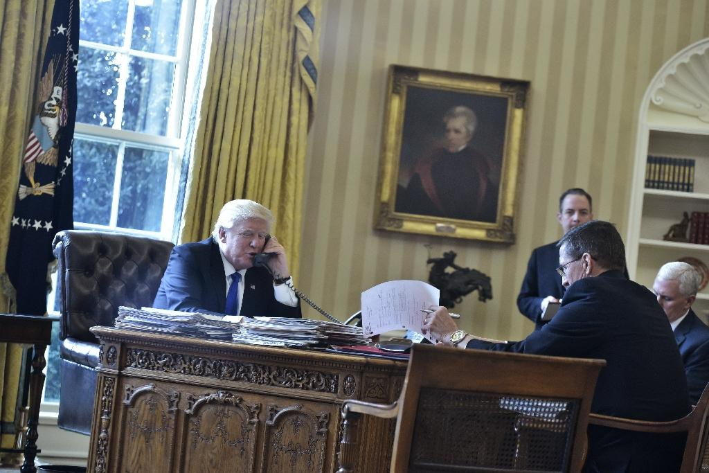 US President Donald Trump speaks on the phone with Russia's President Vladimir Putin from the Oval Office of the White House on January 28, 2017, in Washington, DC (AFP Photo/MANDEL NGAN)