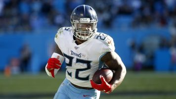 No holdout: Titans' Henry signs franchise tender