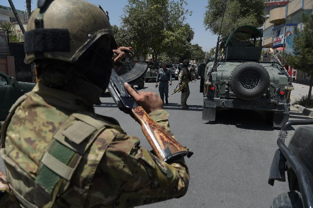 A suicide bomber killed three people including a policeman and wounded five others after blowing himself up near a cricket stadium in the Afghan capital Kabul, police said (AFP Photo/SHAH MARAI)