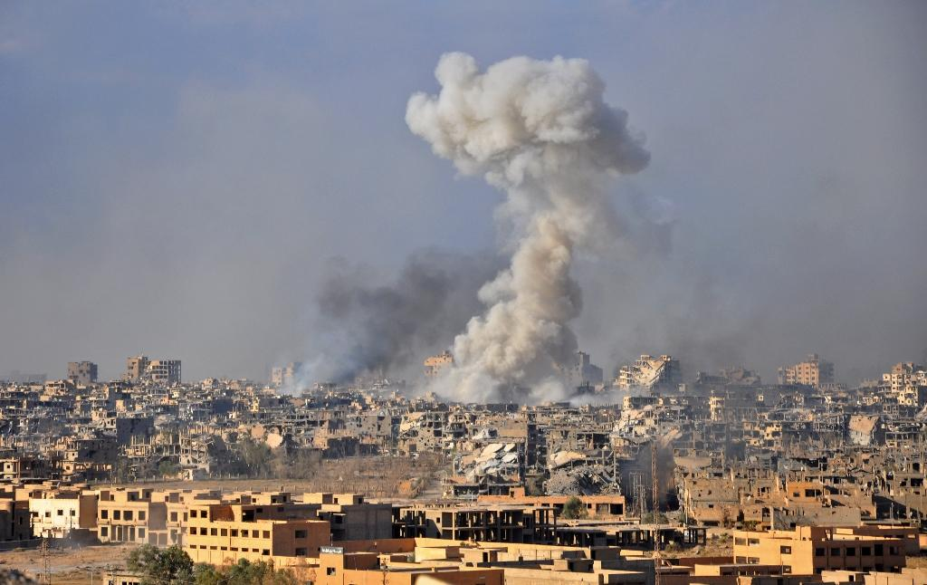 Smoke rises following Syrian government air strikes against Islamic State group jihadists in the eastern province of Deir Ezzor in October 2017