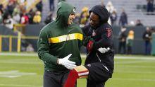 Sherman, Graham hug during pregame warm-ups