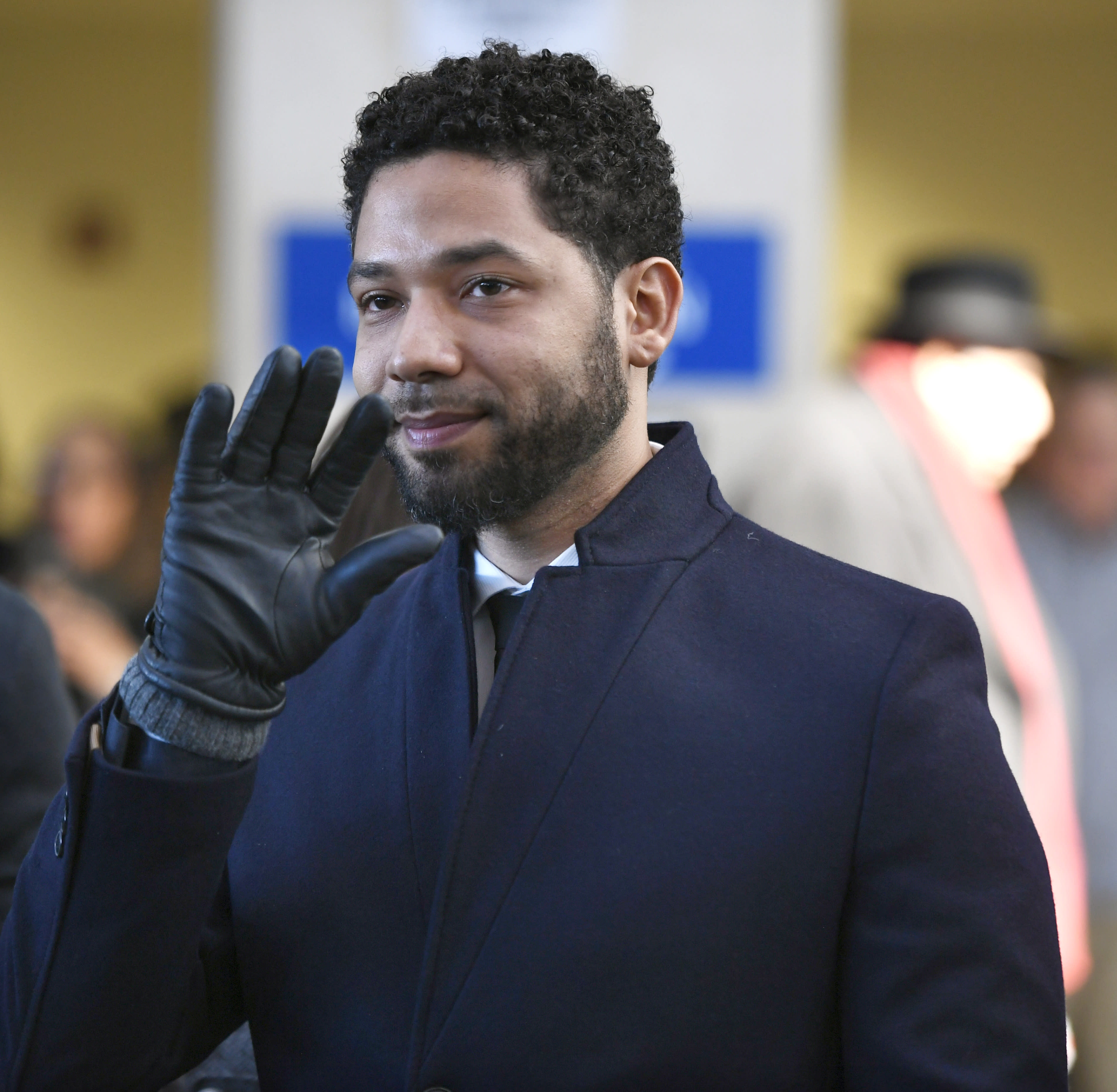 FILE - In this March 26, 2019 file photo, actor Jussie Smollett smiles and waves to supporters before leaving Cook County Court after his charges were dropped, in Chicago. A Chicago judge is expected to decide whether to let a former U.S. attorney stay on as special prosecutor examining the dismissal of charges against actor Smollett. The hearing Friday, Oct. 4, 2019, comes after Dan Webb revealed he co-hosted a fundraiser for Kim Foxx during her 2016 run for Chicago's top prosecutor job. Her office in March abruptly dropped charges accusing Smollett of staging a racist, homophobic attack on himself. (AP Photo/Paul Beaty)