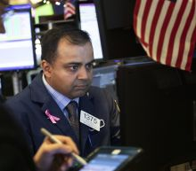 Markets Right Now: Stocks sink, extending losses for year