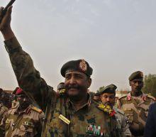 Sudan's top general sworn in as leader of new ruling body