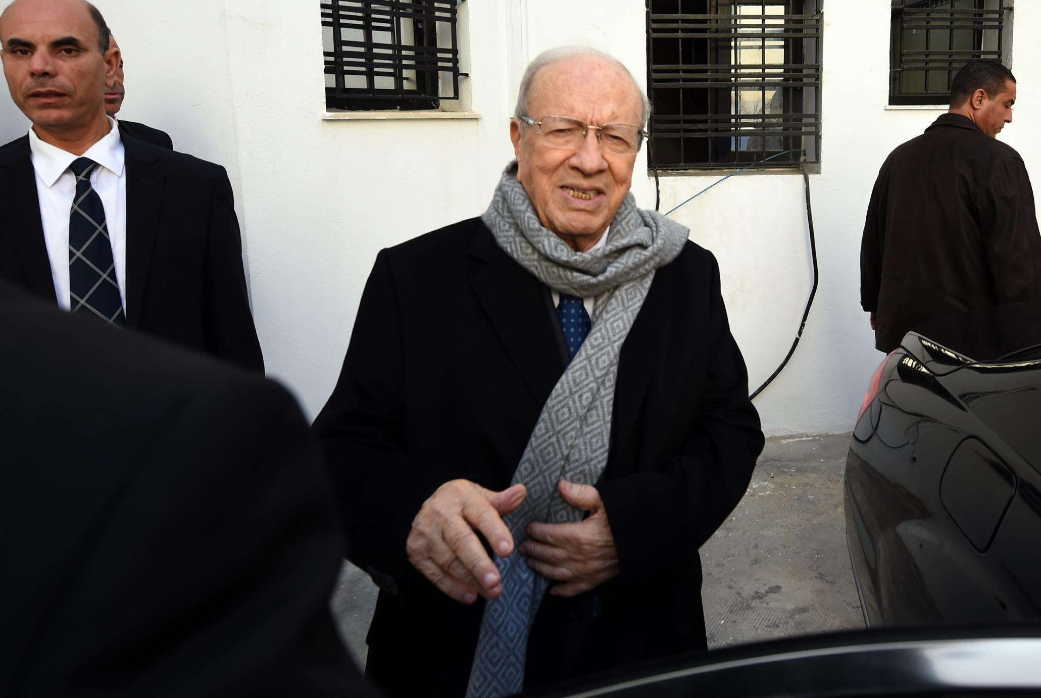 Anti-Islamist Beji Caid Essebsi, named as the winner in Tunisia's first free presidential election, arrives at his party's headquarters on December 22, 2014 in Tunis (AFP Photo/Fethi Belaid)