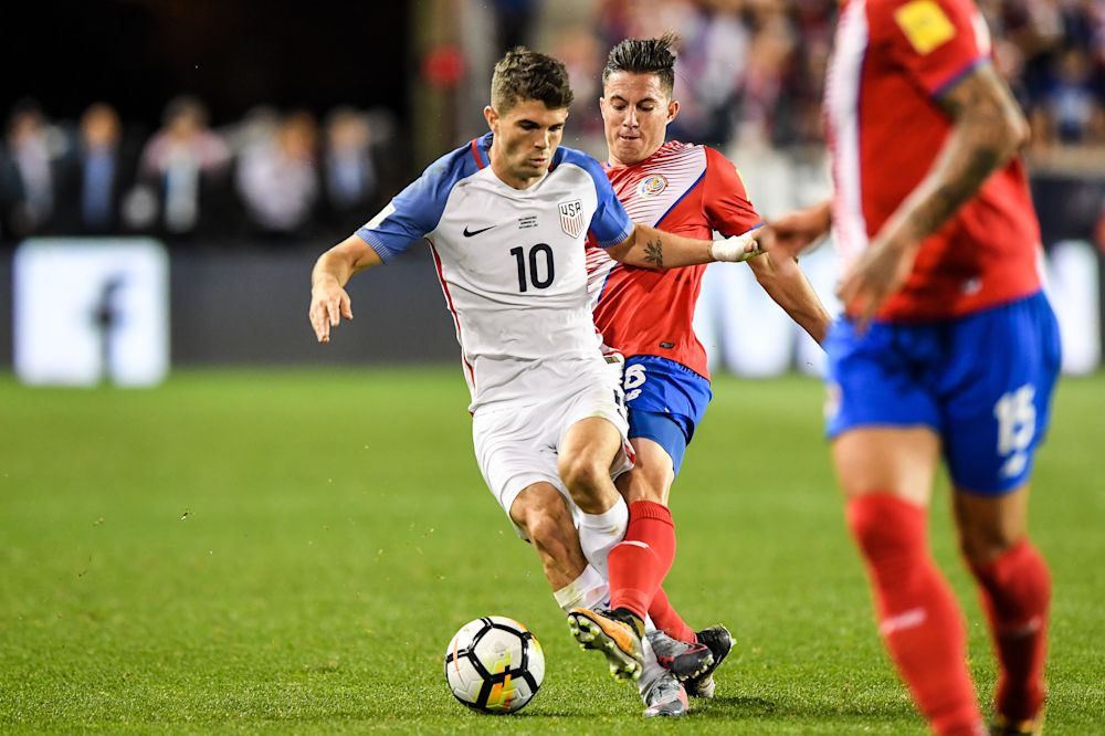 Christian Pulisic is challenged by Costa Rica's Jose Salvatierra. (Getty)