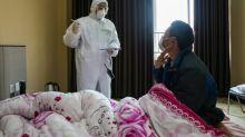 Coronavirus: 563 morts en Chine, les mesures de restrictions s'étendent dans le monde