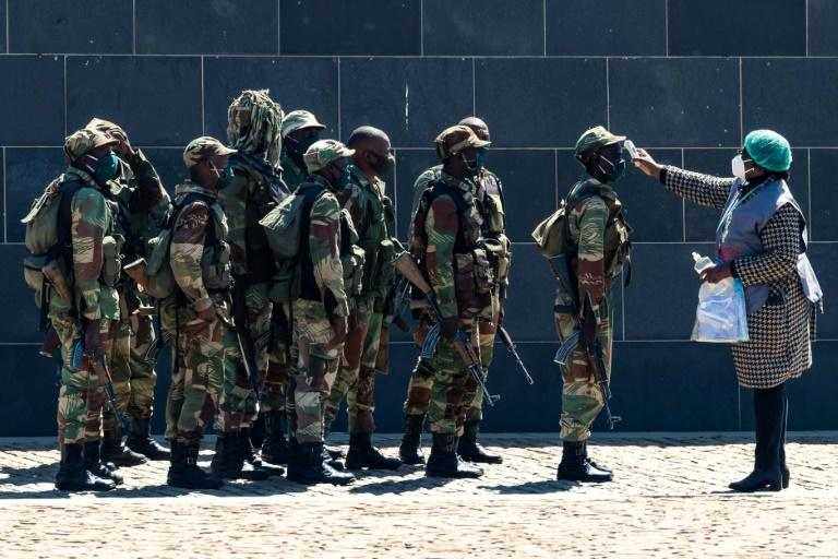 Fever checks for the Zimbabwe military. (AFP Photo/Jekesai NJIKIZANA)