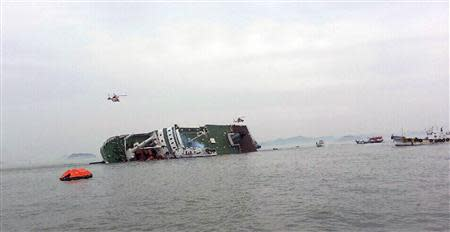A South Korean passenger ship (C) that has been sinking, is seen at the sea off Jindo April 16, 2014. REUTERS/Yonhap