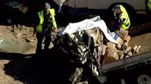 Ute bends in half in horror crash that killed two