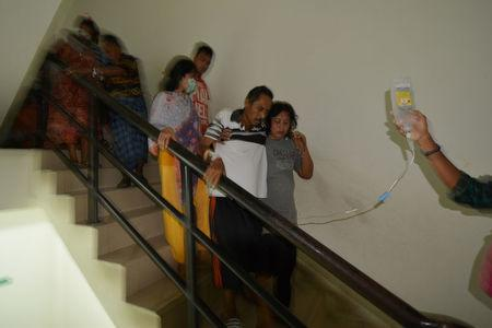 Patients are led down the stairs at Anutapura Hospital following an earthquake in Palu, Central Sulawesi, Indonesia, May 29, 2017 in this photo taken by Antara Foto. Antara Foto/Basri Marzuki/via REUTERS ATTENTION EDITORS - THIS IMAGE HAS BEEN SUPPLIED BY A THIRD PARTY. IT IS DISTRIBUTED, EXACTLY AS RECEIVED BY REUTERS, AS A SERVICE TO CLIENTS. FOR EDITORIAL USE ONLY. NOT FOR SALE FOR MARKETING OR ADVERTISING CAMPAIGNS. MANDATORY CREDIT. INDONESIA OUT. NO COMMERCIAL OR EDITORIAL SALES IN INDONESIA.