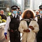 London mayoral candidate arrested after Extinction Rebellion campaigners smash HSBC's windows