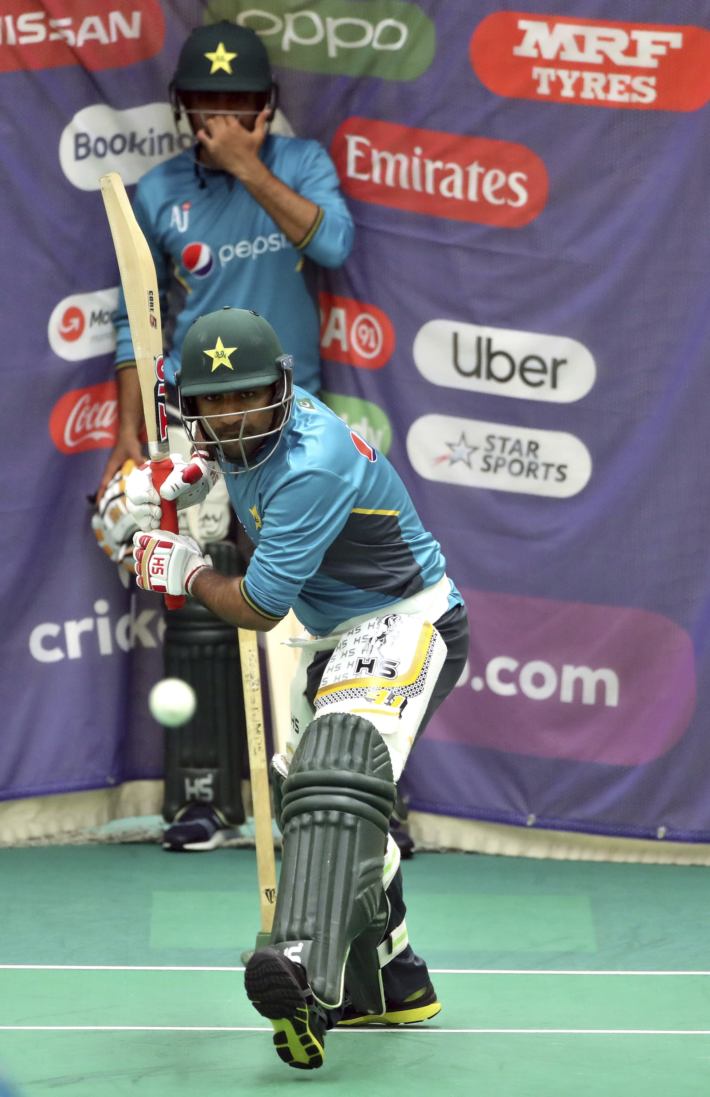 Pakistan's captain Sarfaraz Ahmed, front, bats in the nets during a training session ahead of their Cricket World Cup match against India at Old Trafford in Manchester, England, Saturday, June 15, 2019. (AP Photo/Aijaz Rahi)